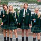 The cast of Derry Girls sport 90s school uniforms