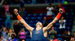 TOPSHOT - Defending champion Rafael Nadal survived an epic US Open quarter-final confrontation to defeat battling ninth seed Dominic Thiem 0-6, 6-4, 7-5, 6-7 (4/7), 7-6 (7/5) and reach the semi-finals for the seventh time. EDUARDO MUNOZ ALVAREZ/AFP/Getty Images
