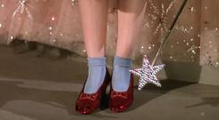 Judy Garland wearing the ruby slippers in The Wizard of Oz