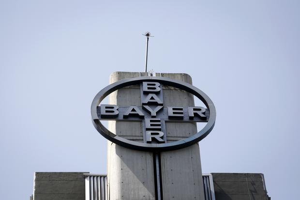 FILE PHOTO: The corporate logo of Bayer is seen at the headquarters building in Caracas May 6, 2015. REUTERS/Carlos Garcia Rawlins/File Photo