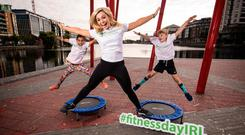 Cork camogie legend Anna Geary with Sibha Bhoja (9) and Conn McCluskey (8) in Dublin yesterday at the launch of Ireland's National Fitness Day. Photo: ©INPHO/Billy Stickland