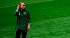 Martin O'Neill takes stock during a training session in Cardiff yesterday. Photo: Stephen McCarthy/Sportsfile