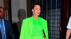 Blake Lively gives the trouser suit trend an update in shocking lime Versace