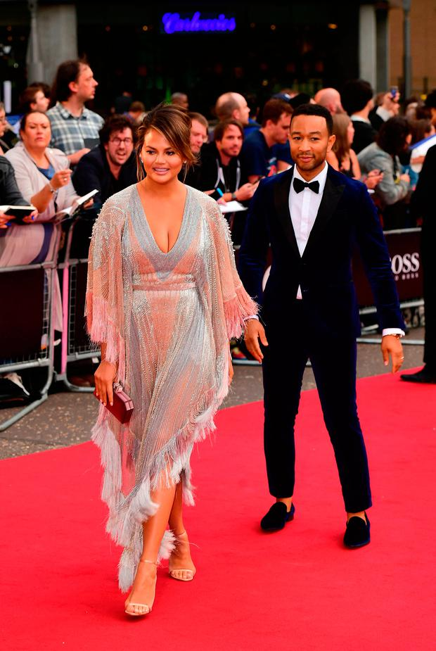 17936a3b82 Chrissy Teigen and John Legend arriving for the GQ Men of the Year Awards  2018 in Association with Hugo Boss held at The Tate Modern in London