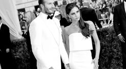 David Beckham (L) and Victoria Beckham attend the