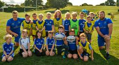 Josh van der Flier and Michael Bent with youngsters enjoying the fun at the Summer Camp at Blackrock RFC