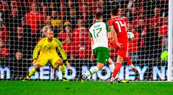 Connor Roberts shoots to score a fourth goal for Wales despite the efforts of Stephen Ward. Photo: Stephen McCarthy/Sportsfile