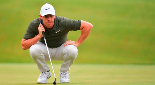 Tiger Woods and Rory McIlroy surrender early lead after frustrating rounds on day two of BMW Championship