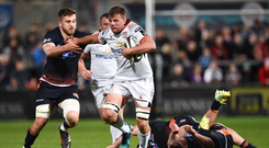 Jordi Murphy of Ulster is tackled by Luke Hamilton of Edinburgh during the Guinness PRO14 Round 2 match between Ulster and Edinburgh Rugby at the Kingspan Stadium in Belfast.