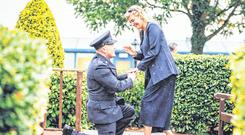 Popping the question: Patrick O'Shea, of Swords, and stationed in Store Street, proposes to his girlfriend and now fiancée Suzanne Walsh, at the Garda passing out parade in Templemore Garda College, Co Tipperary. Photo: Brian Arthur