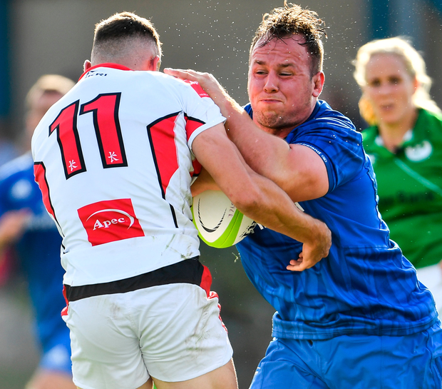 Leinster A's Ed Byrne is challenged by Ulster A's Iwan Hughes. Photo: Sportsfile