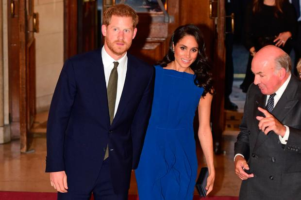 Britain's Prince Harry, Duke of Sussex, and his wife Meghan, Duchess of Sussex arrive to attend 100 Days to Peace in London on September 6, 2018