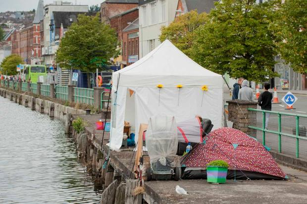 A growing number of rough sleepers have erected tents along St Patricks Quay in the city centre (Photo: Provision)