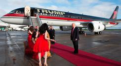 Donald Trump was greeted by a singer and harpists when he arrived at Shannon Airport in 2014