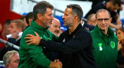 Martin O'Neill looks on as Roy Keane greets his old Man Utd teammate and now Wales manager Ryan Giggs ahead of Ireland's 4-1 defeat by Wales last week. Photo: AFP