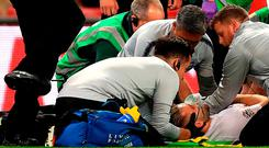 England's Luke Shaw (centre) receives medical treatment after picking up an injury during the UEFA Nations League, League A Group Four match at Wembley