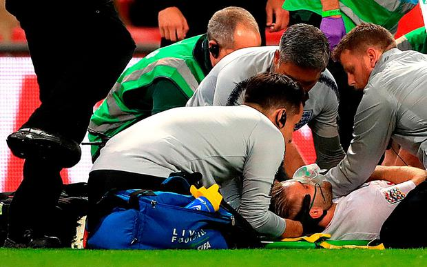 England's Luke Shaw receives medical treatment after picking up an injury during the UEFA Nations League League A Group Four match at Wembley