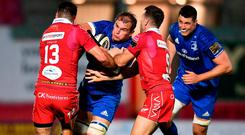 Rhys Ruddock of Leinster is tackled by Kieron Fonotia, left, and Gareth Davies of Scarlets. Photo: Stephen McCarthy/Sportsfile