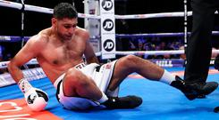 BIRMINGHAM, ENGLAND - SEPTEMBER 08: Amir Khan of England is knocked down by Samuel Vargas of Canada during their Welterweight bout held at Arena Birmingham on September 8, 2018 in Birmingham, England. (Photo by Alex Livesey/Getty Images)