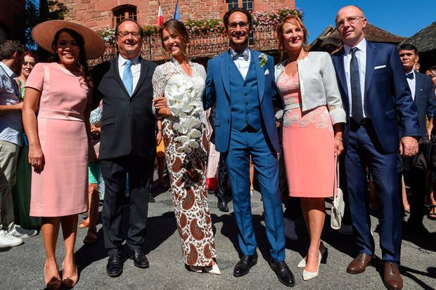 French lawyer Thomas Hollande (3rd R) and French journalist Emilie Broussouloux (3rd L) pose with their parents for pictures during the wedding of their son in Meyssac, September 8, 2018. - Former French President Francois Hollande and French Minister for Ecology, Sustainable Development and Energy, also his former companion Segolene Royal attended the wedding of their son Thomas. (Photo by Mehdi FEDOUACH / AFP) (Photo credit should read MEHDI FEDOUACH/AFP/Getty Images)