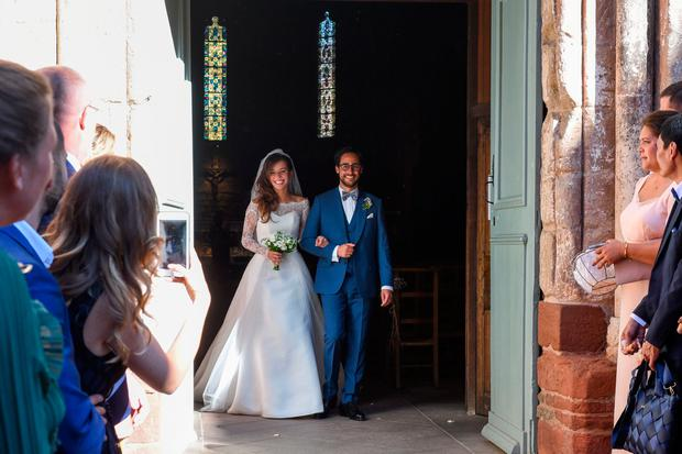 French lawyer Thomas Hollande and French journalist Emilie Broussouloux celebrate as they leave the church after getting married, in Meyssac, on September 8, 2018. - Former French President Francois Hollande and French Minister for Ecology, Sustainable Development and Energy, also his former companion Segolene Royal attended the wedding of their son Thomas. (Photo by Mehdi FEDOUACH / AFP) (Photo credit should read MEHDI FEDOUACH/AFP/Getty Images)