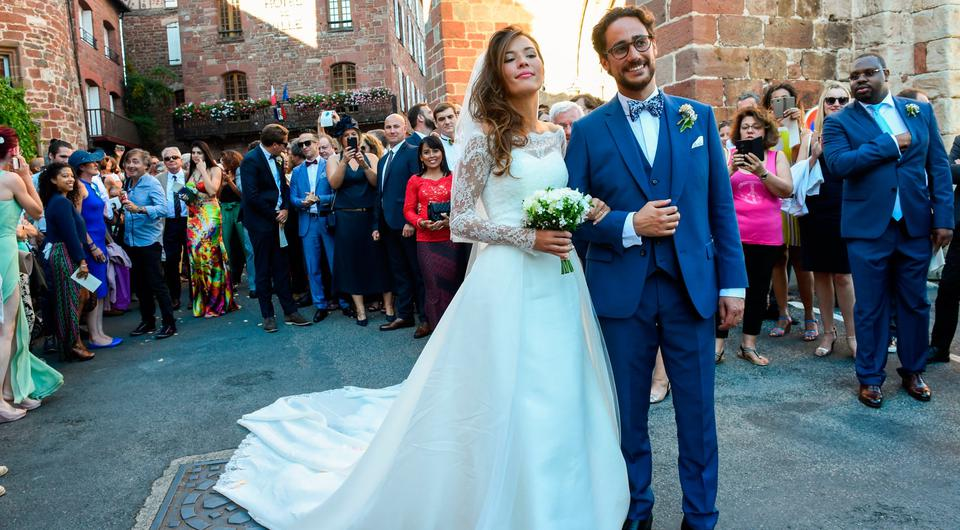 French lawyer Thomas Hollande and French journalist Emilie Broussouloux celebrate and pose for pictures after getting married at the church in Meyssac, on September 8, 2018. - Former French President Francois Hollande and French Minister for Ecology, Sustainable Development and Energy, also his former companion Segolene Royal attended the wedding of their son Thomas. (Photo by Mehdi FEDOUACH / AFP) (Photo credit should read MEHDI FEDOUACH/AFP/Getty Images)