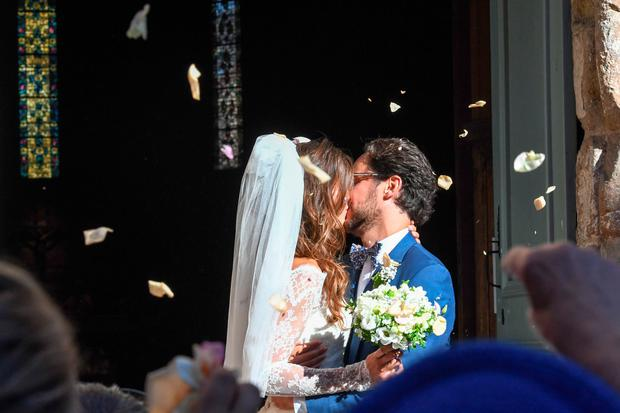 French lawyer Thomas Hollande and French journalist Emilie Broussouloux kiss and celebrate after getting married at the church in Meyssac, on September 8, 2018. - Former French President Francois Hollande and French Minister for Ecology, Sustainable Development and Energy, also his former companion Segolene Royal attended the wedding of their son Thomas. (Photo by Mehdi FEDOUACH / AFP) (Photo credit should read MEHDI FEDOUACH/AFP/Getty Images)