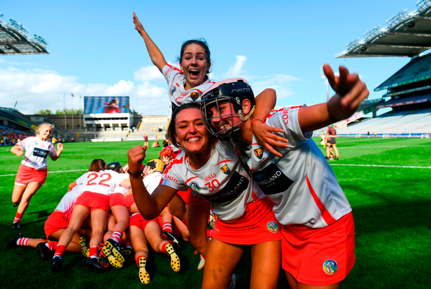 Katelyn Hickey, right, Saoirse McCarthy, centre, and Katie Barry of Cork celebrate following the Liberty Insurance All-Ireland Intermediate Camogie Championship Final match between Cork and Down at Croke Park in Dublin.