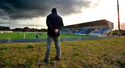 A supporter stands alone as he watches the teams warming up before the Athlone v Cobh Ramblers match in the League of Ireland First Division tie last month. Photo: Ray Ryan