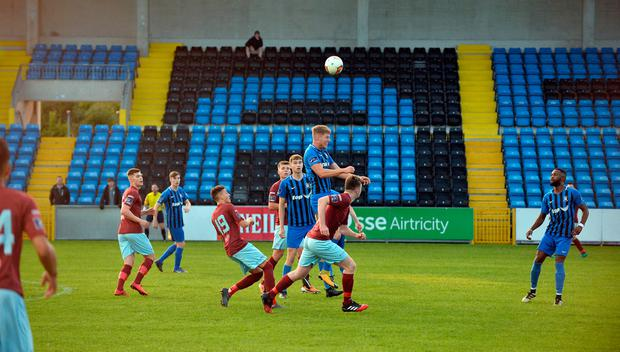 Cobh Ramblers and Athlone Town players compete in front of a sparse crowd. Photo: Ray Ryan