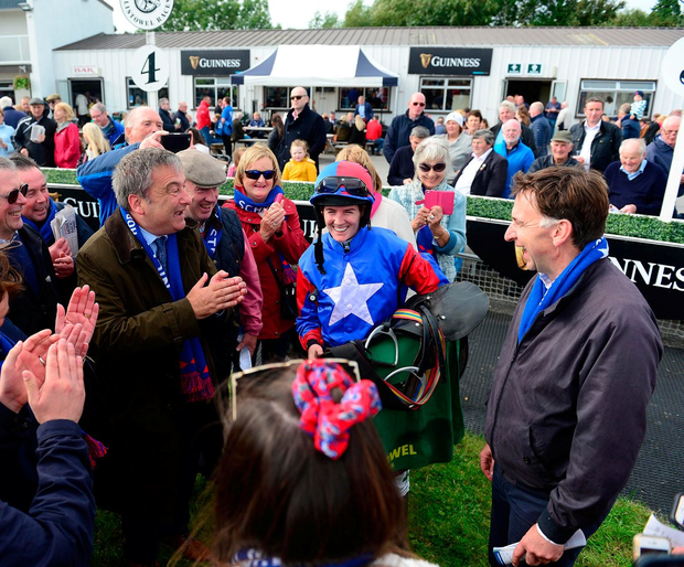 Ellie Mac's owner John Schuster (left) and connections with jockey Rachael Blackmore and trainer Henry de Bromhead (right) after the horse finished runner-up in yesterday's Mares Novice Chase.at Listowel. Photo: Healy Racing