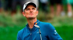 Justin Rose leads by a shot after his third-round 64 on Saturday getty. Photo: Gregory Shamus/Getty Images