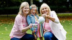 Breast cancer survivor Sarah Murray from Malahide and daughter Sadie (4) are pictured with RTÉ broadcaster Miriam O'Callaghan at the campaign launch. Picture: Andres Poveda