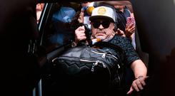Diego Maradona brings plenty of baggage with him, and some rather large hand luggage, as he touches down in Mexico City over the weekend. Photo: Getty Images