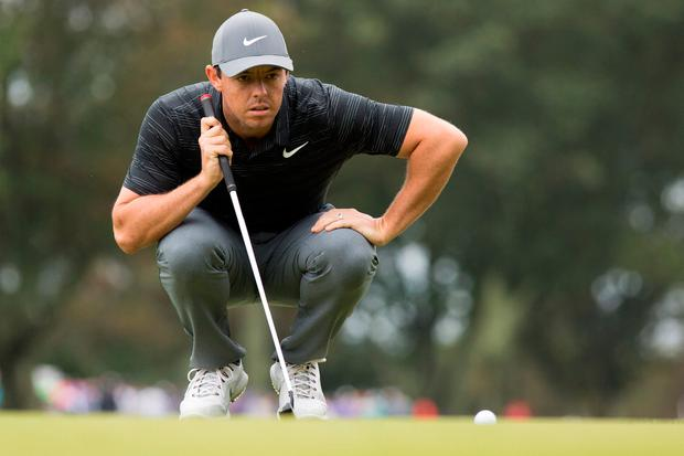 Sep 8, 2018; Newtown Square, PA, USA; Rory McIlroy lines up his putt on the 3rd green during the third round of the BMW Championship golf tournament at Aronimink GC. Mandatory Credit: Bill Streicher-USA TODAY Sports