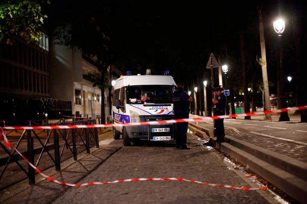Police officers secure the site of a knife attack in Paris. (AP Photo/Thibault Camus)
