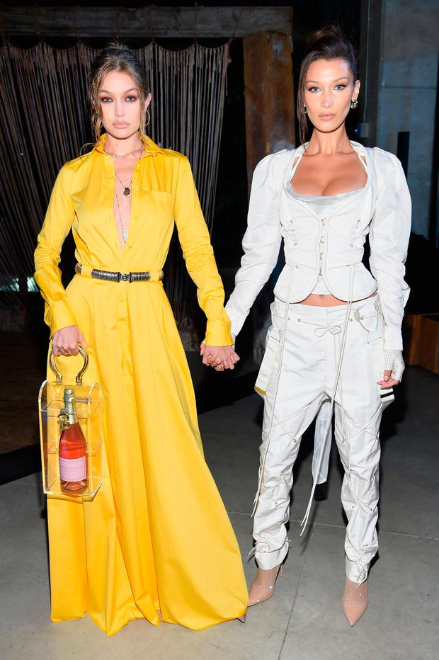 Gigi Hadid and Bella Hadid attend the #BoF500 gala dinner during New York Fashion Week Spring/Summer 2019 at 1 Hotel Brooklyn Bridge on September 9, 2018 in Brooklyn City. (Photo by Dimitrios Kambouris/Getty Images for The Business Of Fashion )