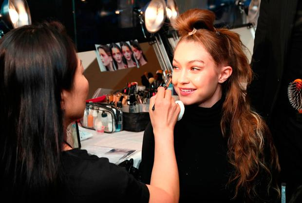 Model Gigi Hadid prepares backstage for the Anna Sui show during New York Fashion Week: The Shows at Gallery I at Spring Studios on September 10, 2018 in New York City. (Photo by Astrid Stawiarz/Getty Images for NYFW: The Shows)