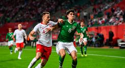 Callum O'Dowda of Republic of Ireland in action against Tomasz Kedziora of Poland during the International Friendly match between Poland and Republic of Ireland at the Municipal Stadium in Wroclaw, Poland. Photo by Stephen McCarthy/Sportsfile