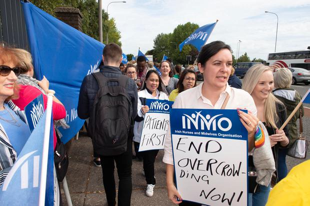 Pressure: Nurses and midwives protesting outside Cork University Hospital yesterday. Photo: Michael Mac Sweeney/Provision