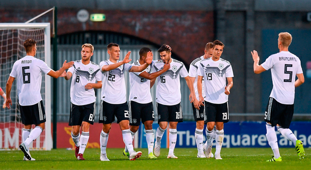Suat Serdar of Germany (16) is congratulated after scoring his side's fifth goal. Photo: Sportsfile