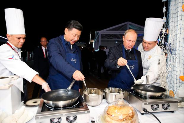Presidents Vladimir Putin and Xi Jinping make pancakes at the Eastern Economic Forum in Vladivostok, Russia. Photo: Reuters