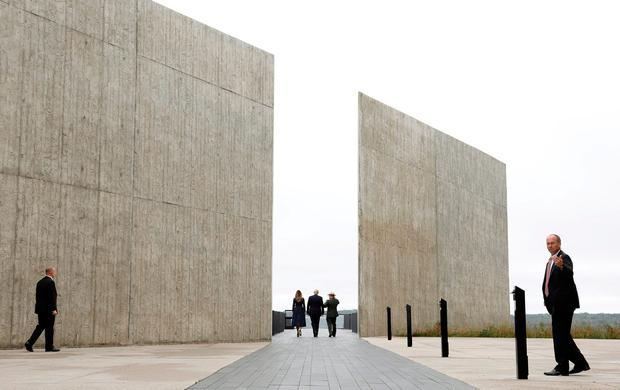 U.S. President Donald Trump and first lady Melania Trump walk with park superintendent Stephen Clark at the Flight 93 National Memorial near Shanksville, Pennsylvania. Photo: Reuters
