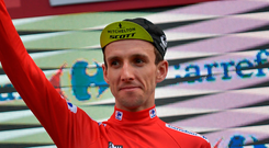 Simon Yates of Britain waves after receiving the Red Leader shirt. Photo: AP