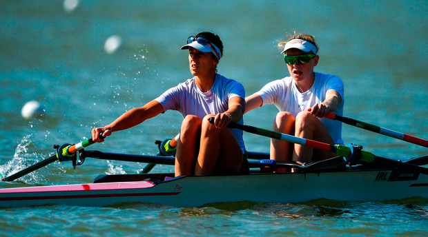 Denise Walsh, left, and Aoife Casey of Ireland make their way to the start for their Lightweight Women's Double Sculls repechage event. Photo: Seb Daly/Sportsfile