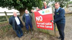 Brendan Stafford, Gerry McCann, Meath IFA Chairman John Curran, Michael McCann, David Farrell & Farm Business Chairman Martin Stapleton putting up a sign on the McCann farm in Meath, opposing the forced sale of the farm. Photo: Finbarr O'Rourke