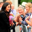 Postcard image: Prince Harry and Meghan Markle meet fans in Trinity College after viewing the 'Book of Kells' in July. Photo: Gerry Mooney