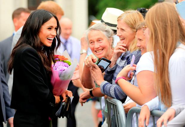 Postcard image Prince Harry and Meghan Markle meet fans in Trinity College after viewing the 'Book of Kells' in July