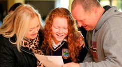 Making the grade: Leah Nolan goes over her results with parents Nicola and Bryan at Donabate Community College, Dublin. Photo: Gerry Mooney