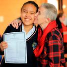 Proud mum: Sinadalahi Badmus (15) with her mother Triona Bonner-Badmus at Donabate College. Photo: Gerry Mooney
